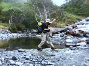 Robb rock hopping across a creek.